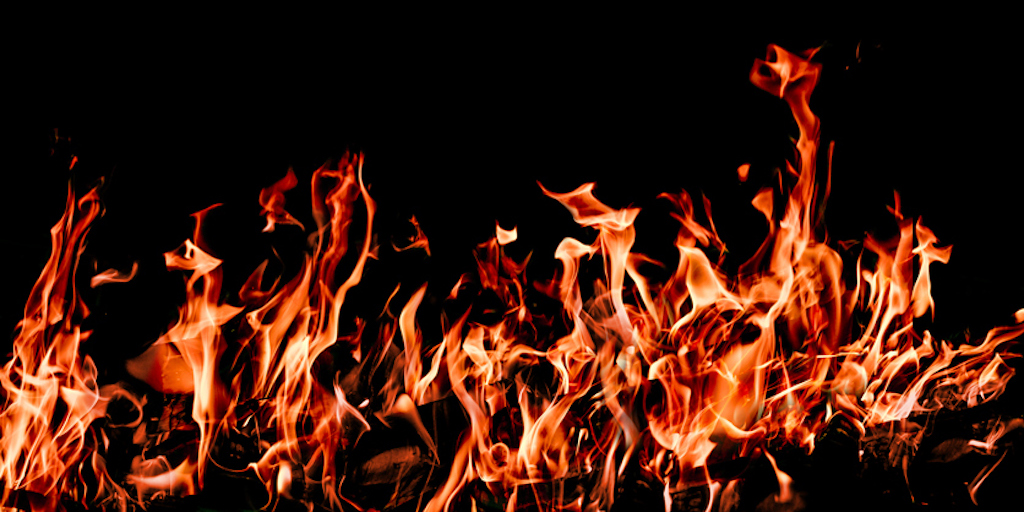 """Fire, isolated on black background.""(c)Istock Renphoto"